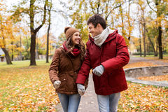 Happy young couple walking in autumn park Royalty Free Stock Images