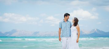Happy young couple walking on beach Royalty Free Stock Photo