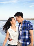 Happy young couple walking on the beach Royalty Free Stock Photos