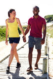 Happy young couple walking from the beach Stock Photo