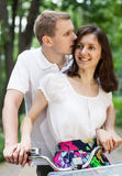 Happy young couple walking with bicycles Royalty Free Stock Photo