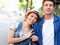 Happy young couple walking in city Stock Photography