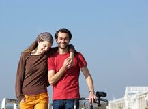 Happy young couple walking outdoors Royalty Free Stock Photos