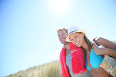 Happy young couple walking outdoors on a hot sunny day Royalty Free Stock Photo