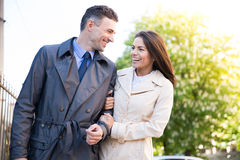 Happy young couple walking outdoors Royalty Free Stock Photo