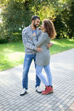Happy young couple walking in park embraced  young couple in the Royalty Free Stock Image