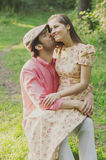 Happy young couple walking in the park Stock Photo