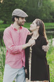 Happy young couple walking in the park Royalty Free Stock Photos