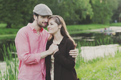 Happy young couple walking in the park Royalty Free Stock Photography