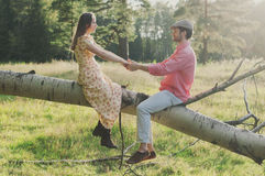 Happy young couple walking in the park Stock Photos