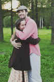 Happy young couple walking in the park Stock Photography