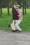 Happy young couple walking in the park Stock Images