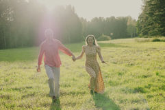 Happy young couple walking in the park Royalty Free Stock Images