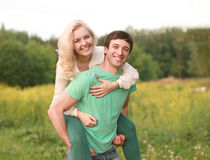 Happy young couple walking in summer day stock photo