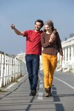 Happy young couple walking on their date Stock Images