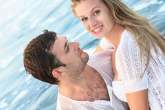Happy young couple in a water Royalty Free Stock Images