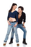 Happy young couple wearing jeans Stock Photos