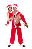 Happy young couple wearing santa claus clothes Royalty Free Stock Images