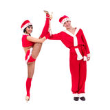 Happy young couple wearing santa claus clothes Stock Photos