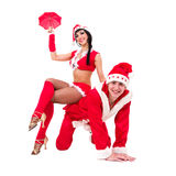 Happy young couple wearing santa claus clothes Royalty Free Stock Photos