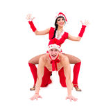 Happy young couple wearing santa claus clothes Stock Images