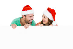 Happy young couple wearing santa hat Royalty Free Stock Image