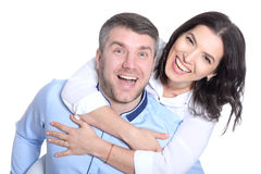 Happy young couple on a white background. Portrait of a happy young couple on a white background royalty free stock photos