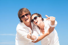 Happy young couple in white clothes having fun on Stock Images
