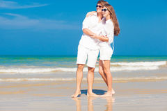 Happy young couple in white clothes having fun on Royalty Free Stock Photo