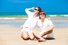 Happy young couple in white clothes in sunglasses Royalty Free Stock Photo