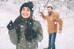 Happy Young Couple in Winter . Family Outdoors. man and woman looking upwards and laughing. Love, fun, season and people royalty free stock image