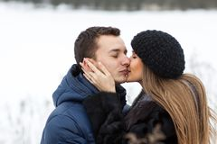 Happy Young Couple in Winter field Stock Photography