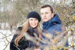 Happy Young Couple in Winter garden Royalty Free Stock Images