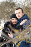 Happy Young Couple in Winter garden Stock Photos