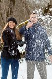 Happy Young Couple in Winter garden Stock Photo