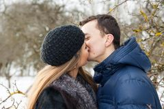 Happy Young Couple in Winter garden Stock Photography