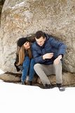 Happy Young Couple in Winter mountains Stock Images