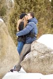 Happy Young Couple in Winter mountains Stock Photography
