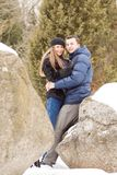Happy Young Couple in Winter mountains Royalty Free Stock Photography