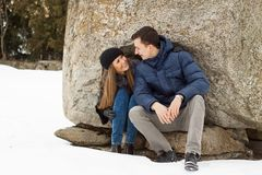 Happy Young Couple in Winter mountains Stock Image