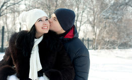 Happy young couple in winter Royalty Free Stock Image
