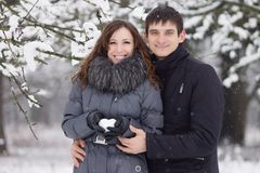 Happy young couple in winter park. Stock Photos
