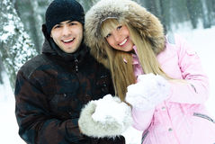 Happy young couple in winter park Stock Image