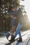 Happy Young Couple in Winter Park. Family Outdoors. love concept Royalty Free Stock Images