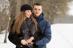 Happy Young Couple in Winter Park having fun Stock Image