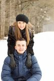 Happy Young Couple in Winter Park having fun Stock Photos