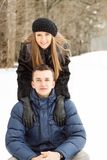 Happy Young Couple in Winter Park having fun Royalty Free Stock Photography