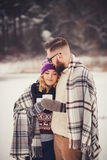 Happy young couple in winter park Royalty Free Stock Images