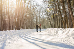 Happy Young Couple in Winter Park having fun. Family Outdoors. love Royalty Free Stock Photo