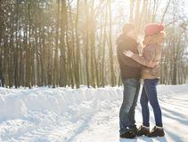 Happy Young Couple in Winter Park having fun. Family Outdoors. love Stock Photography